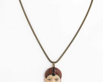 """Vintage carved and painted celluloid pendant on 16"""" brass chain. pdvn804cs(e)"""