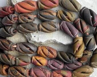 Australian Bilderjaspis - engraved cylinders - 40 cm strand