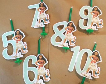 Green candles with cardboard die-themed number oceania v moana available from 5 to 10