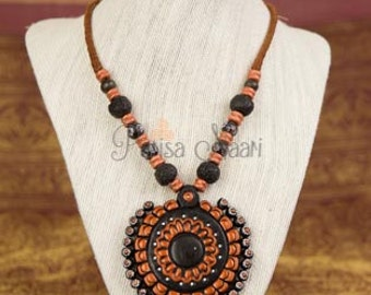 Black and ochre terracotta necklace with a bold chunky pendant.