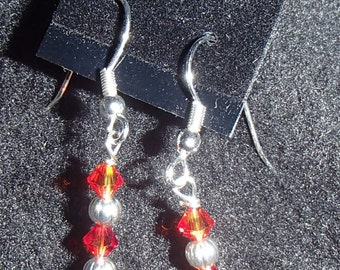 Orange and silver earrings