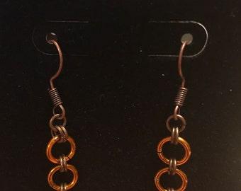 Bronze and orange dangle earrings