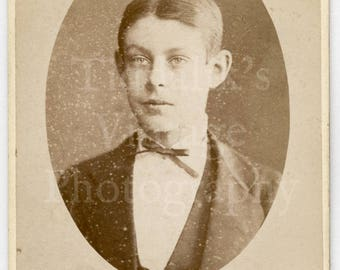 CDV Carte de Visite Photo - Victorian Young Handsome Boy Portrait Wearing Bow Tie Oval Frame - A Maddison of Huntingdon England - Antique