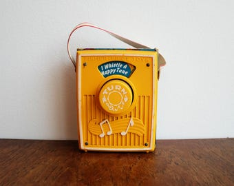 "1977 Fisher Price Pocket Radio Musical Toy - playing ""I Whistle a Happy Tune"""