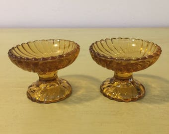 Set of two Portieux French Pedestal Pressed Glass Amber colored Salt Cellars