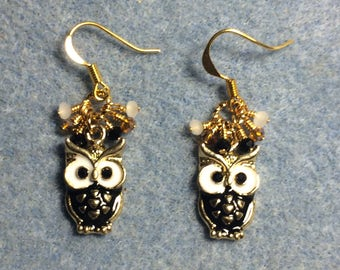 Black and white enamel and rhinestone owl charm earrings adorned with tiny dangling black, white, and amber Chinese crystal bead.
