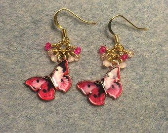 Pink and black enamel butterfly charm dangle earrings adorned with tiny hot pink and light pink Chinese crystal beads.