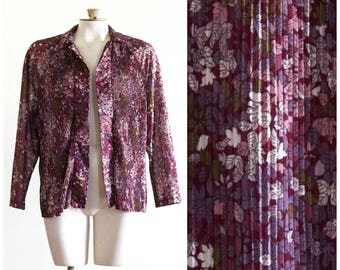 Purple pleated blouse with leaf print