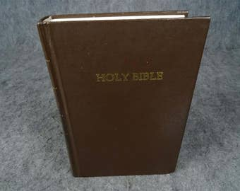 Holy Bible In New International Version By International Bible Society.