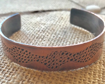 Etched copper cuff with abstract design