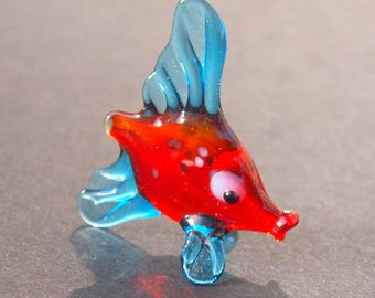 Glass tropical fish with adorable face expression. Detailed figurine with a lot of