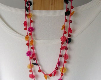 Multi coloured double stranded extra long crocheted necklace-black-deep pink-orange-yellow-metal free- 28 to32 inches long-statement piece.
