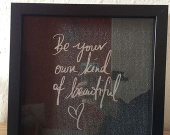 """Black frame with silver vinyl """"Be your own kind of beautiful"""""""