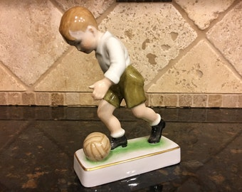 Hungarian Zsolnay Porcelain Figurine Child Kicking Ball, 5.5 inches by 4 inches Five Tower Mark ~ Made in Hungary