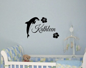 Dolphin with name and hibiscus vinyl wall decal.   Would look great in the nursery or child's room.