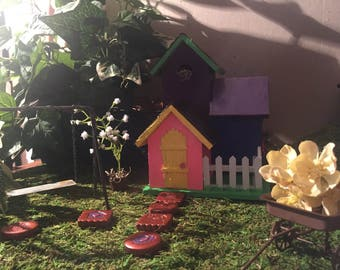 Adorable fairy garden miniatures. Rose gold stepping stones, lavender plant in clay pot, rustic watering can. Snail, blue bird, lady bug