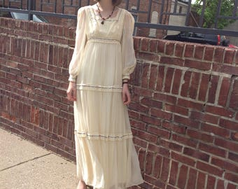 1970s ivory boho long dress with sheer sleeves and floral/lace adornments
