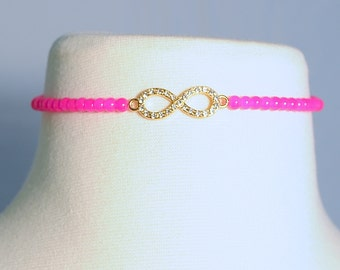 Hot Pink beaded choker with an infinite charm