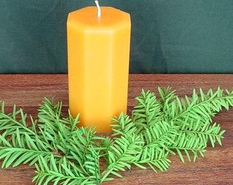 Orange octogon paraffin wax pillar candle