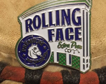 Rolling Face hat pin