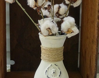 Antique glass milk bottle with cotton bolls, chalk painted, distressed, and wound with twine.