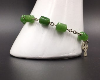 Sterling and jade vintage prayer bracelet with sterling Celtic Sun Cross by manufacture Bliss.