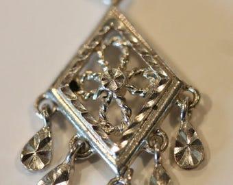 Sterling silver etched dangle fringe type pendant