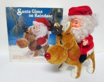 Vintage Musical Santa Claus on Reindeer Christmas Figurine Lighted Decoration Amscan
