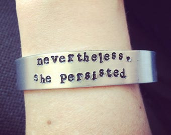 Nevertheless, she persisted - stamped aluminum cuff bracelet.