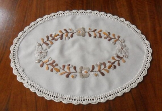 Hand embroidered oval doily with crocheted borders (MKDOI-BROWN-249)