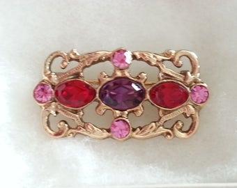 Vintage, pink, red, purple rhinestone, gold tone metal brooch, 1950-1960