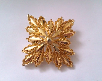 WEST signed star shaped brooch