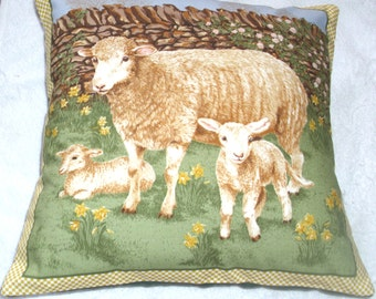 A lovely cushion with a sheep and two lambs in Springtime