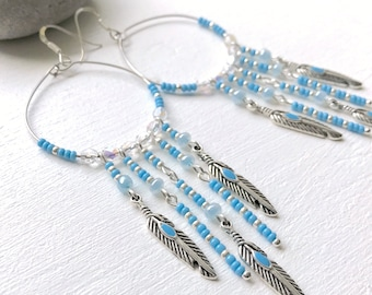 Large silver and turquoise feather earrings