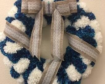 Yarn pom pom wreath