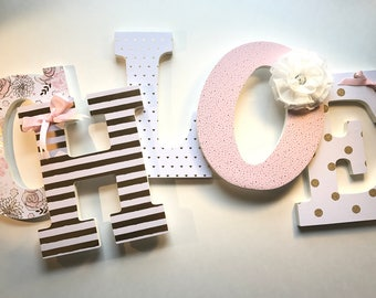 Pink white and gold girls nursery letters in Chloe