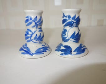 Pair of small hand painted china candle holders