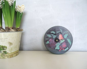 Clock made from a biscuit tin