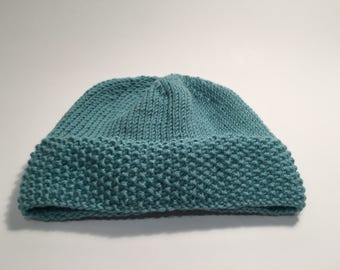 Hand knitted baby hat.