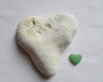 Heart of stone, including a fossil. Fossil heart shape roller. Ideal for heart collection!