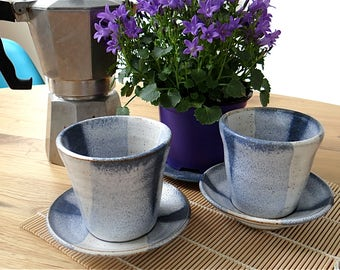 Handmade ceramic cup tumbler beaker and saucer set made of stoneware clay and glazed in blue and white