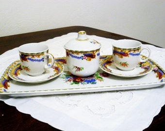 Elegant set of fine porcelain Limoges/Elegant fine china Limoges
