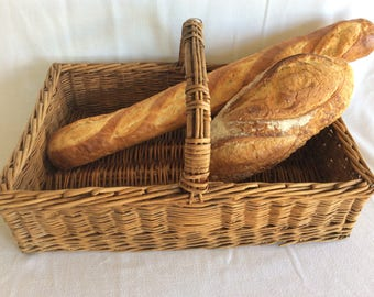 Vintage bread bakery display traditional French wicker basket