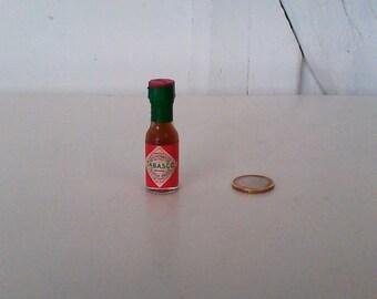 Small cut glass vintage TABASCO bottle.