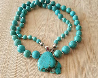 Womens necklace Turquoise colored beads and center
