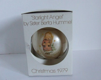Retro Schmid Christmas 1979 tree ornament Starlight Angel by Sister Berta Hummel cute child angel holding a candle on a round glass ball