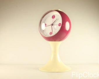 Beautiful vintage 60s 'Blessing' alarm clock on pedestal. Pink and beige!