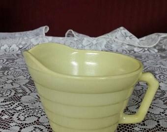 Platonite milk glass yellow pitcher. Hazel atlas.