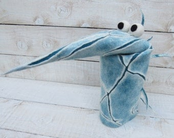 wet felted puppet, blue white hand puppet, long pointy nose with spikes down the back