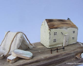 Glamping Whitewashed driftwood cottage with little canvas tent